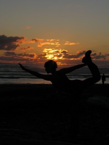 bow pose sunset